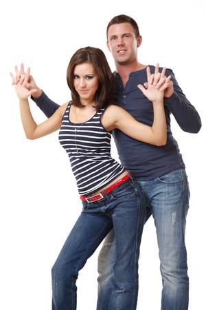 young nice couple dancing on white background photo