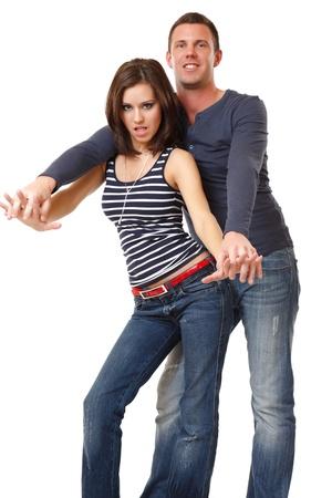 young couple dancing in studio photo