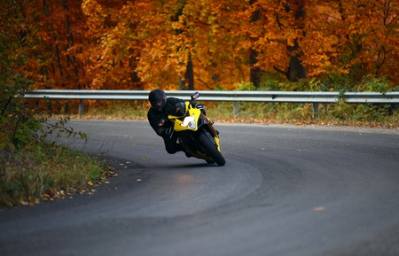 biker in autumn  photo