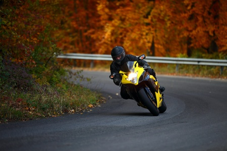 man riding with speedbike in autumn photo