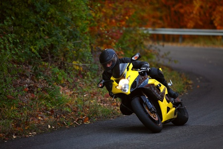 motorbike pilot coming out from curve Stock Photo