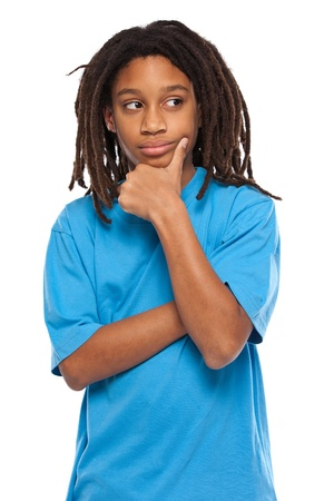 young african boy thinking in studio photo