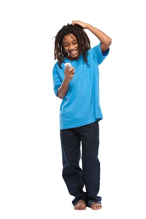 young african boy posing with cellphone in studio photo