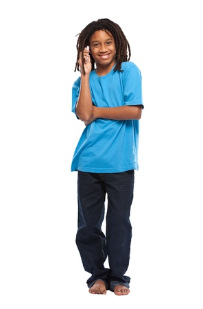 young african boy posing with cellphone in studio Stock Photo - 11453465