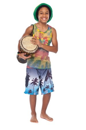rasta boy with hand made drum in studio photo