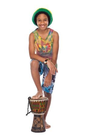african drums: young rasta man standing in studio