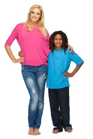 black man white woman: blonde woman posing with rasta boy in studio Stock Photo