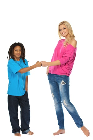 rasta colors: cute blonde woman with her young rasta brother in studio