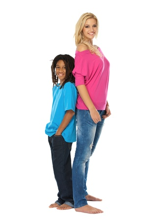 adult sisters: rasta boy and young blonde woman posing in studio Stock Photo