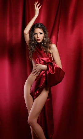 sexy woman wrapped in red fabric photo