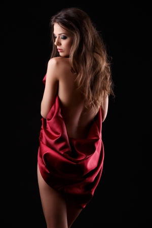 beautiful woman standing in red fabric
