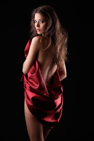 sexy woman posing in red textile Stock Photo