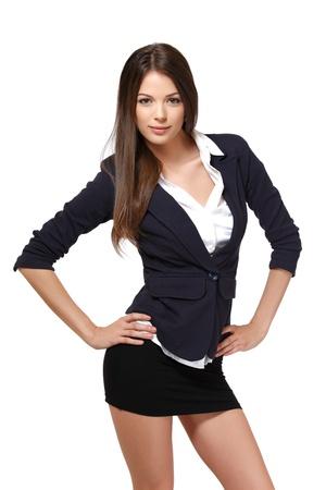 mini falda: hermosa mujer posando sobre fondo blanco Foto de archivo
