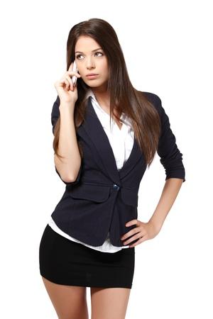 la mujer con el tel�fono, aislado en blanco Foto de archivo
