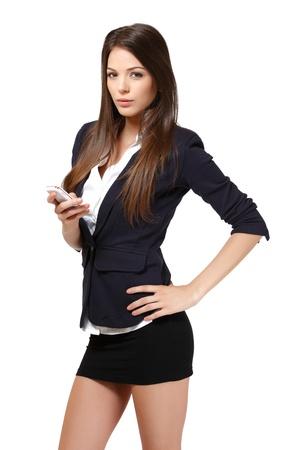 mini jupe: femme avec un téléphone dans le studio