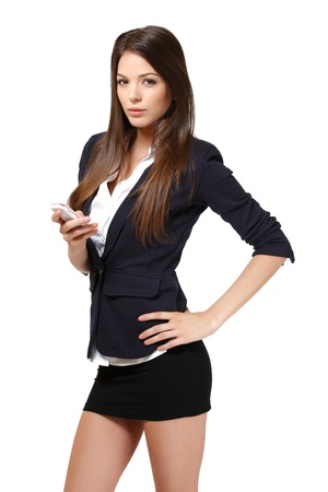businesswoman skirt: woman with phone in studio Stock Photo