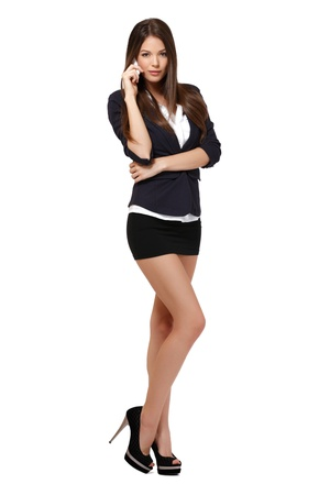 businesswoman skirt: businesswoman with phone in studio Stock Photo