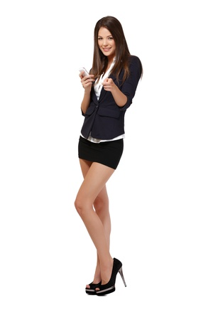mini jupe: femme avec un téléphone isolé sur blanc Banque d'images