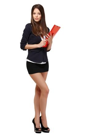 mini jupe: femme mignonne posant en studio
