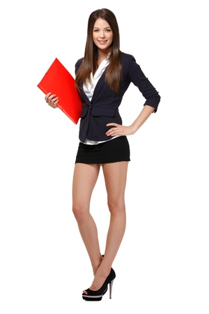 slim businesswoman standing in studio Stock Photo