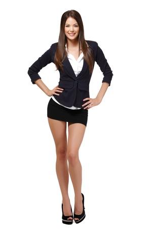 mini jupe: femme heureuse isolé sur blanc Banque d'images