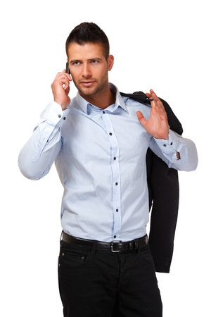 young man with phone in studio photo
