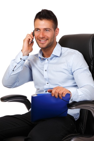man making a call and holding a blue folder photo