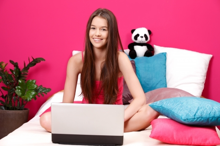 young beautiful woman read email on her laptop photo