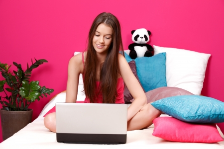 young slim woman using laptop photo