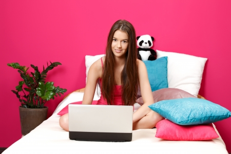 young cute woman in her room photo