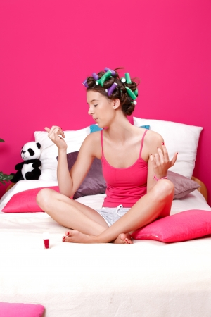 young beautiful woman blow her nails photo