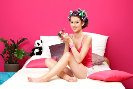 young woman applying lipstick and doing her make up ready Stock Photo - 14013879