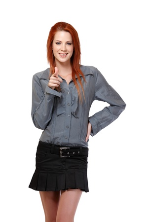 nice woman with red hair posing in studio