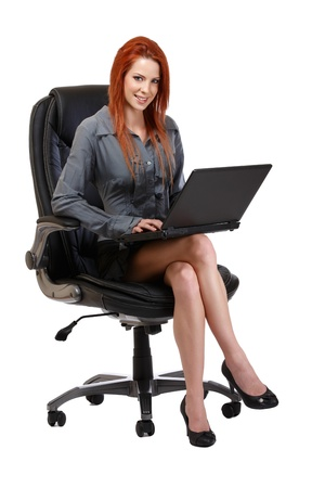 woman posing with laptop on chair, isolated on white photo