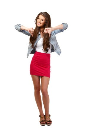 long skirt: young woman posing with thumbs down