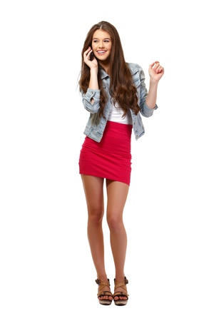 nice young woman speaking on phone in studio Stock Photo - 14724221