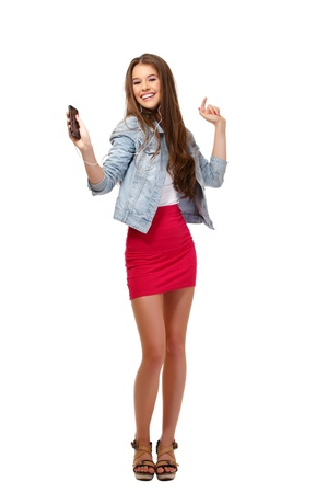 nice young woman posing with earphone in studio Stock Photo - 14724218