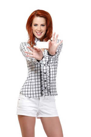 portrait of a nice woman with red hair holding a card, isolated on white photo