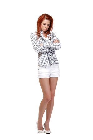 woman with red hair posing in studio photo