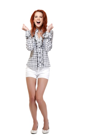 piernas mujer: mujer feliz con el pelo rojo aislado en blanco Foto de archivo