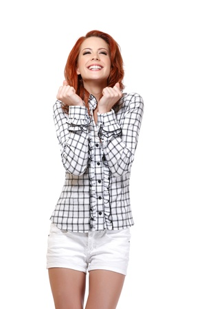 happy woman with red hair posing on white background photo