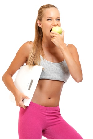 slim young woman bites an apple and posing photo