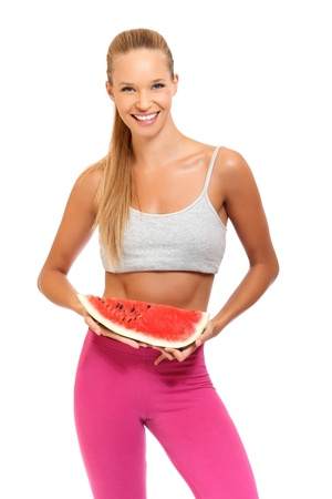 happy blonde woman smiling with melon on white background photo