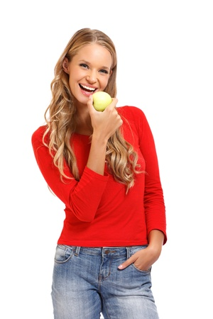 pretty blonde woman eating apple on white background photo