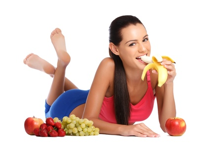 beautiful brunette woman posing with fruits on white background Stock Photo