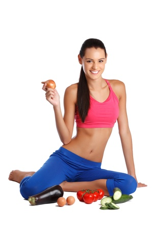 thin bulb: nice young woman posing with healthy foods