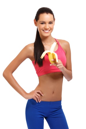 tight body: cute brunette lady with fruit isolated on white Stock Photo