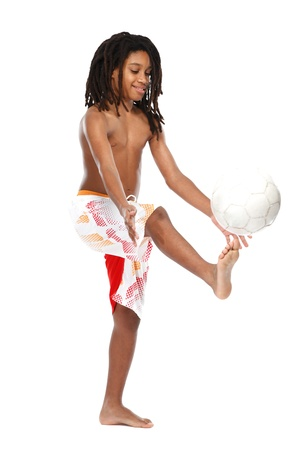 futball: young rasta teenager playing football on white background Stock Photo