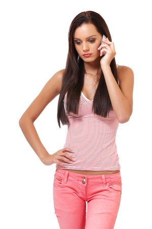 angry young woman with cellphone in studio photo