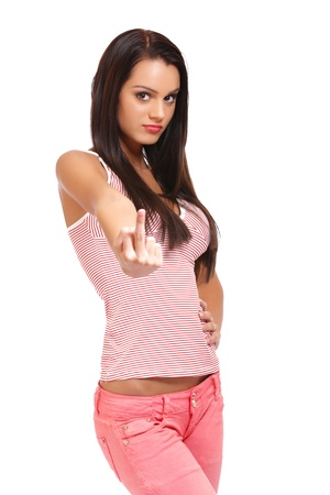 arrogant teen: teenager in pink dress showing middle finger Stock Photo
